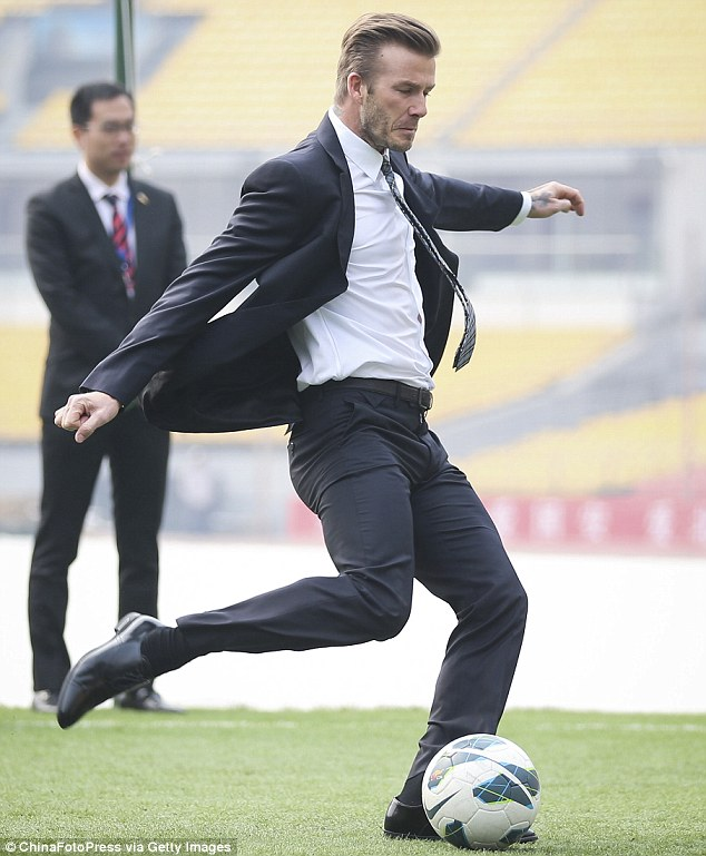 playing football in suit